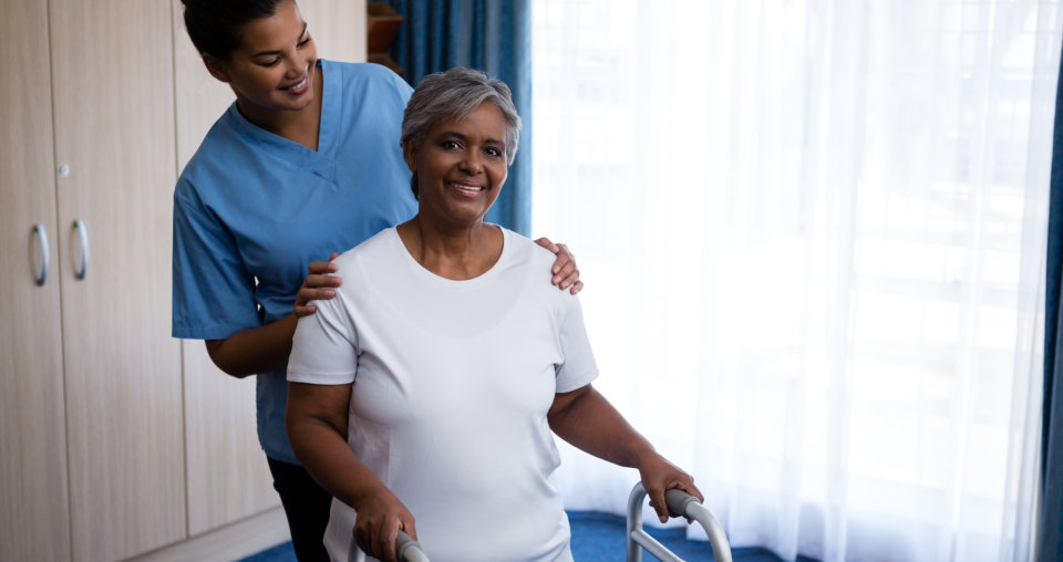 caregiver assisting a senior patient