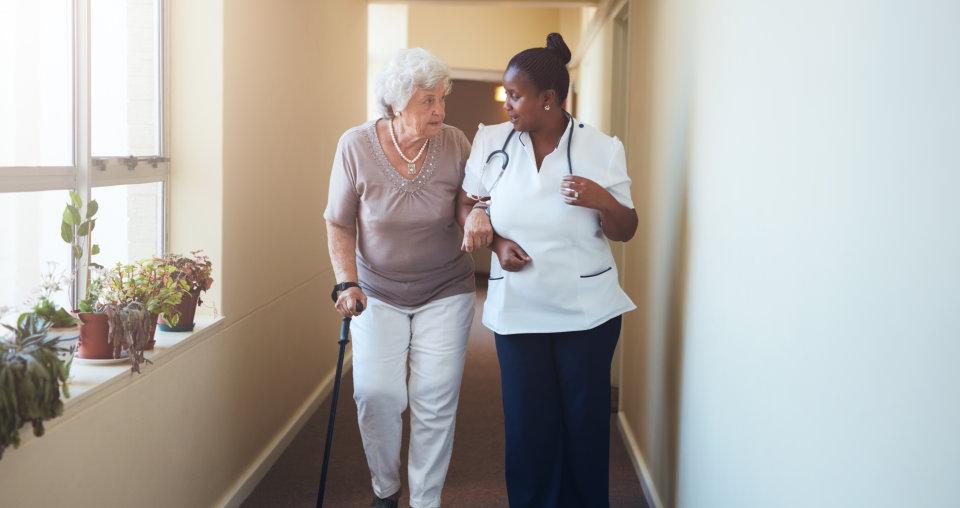 senior woman and a caregiver